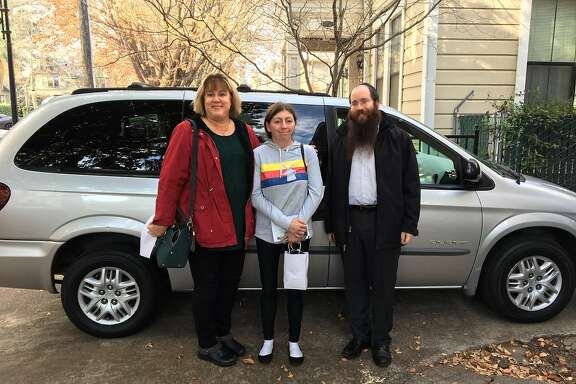 The Chabad Jewish Center of Chico is helping with disaster relief for displaced survivors of the November 2018 Camp Fire in Paradise, Calif. The donations that help the most, said Rabbi Mendy Zwiebel, are the donations of cars. Patricia Ansorge, left, donated her car in 2019 to Melissa Najera, center, through the Chabad center in Chico run by Rabbi Mendy Zwiebel, right.