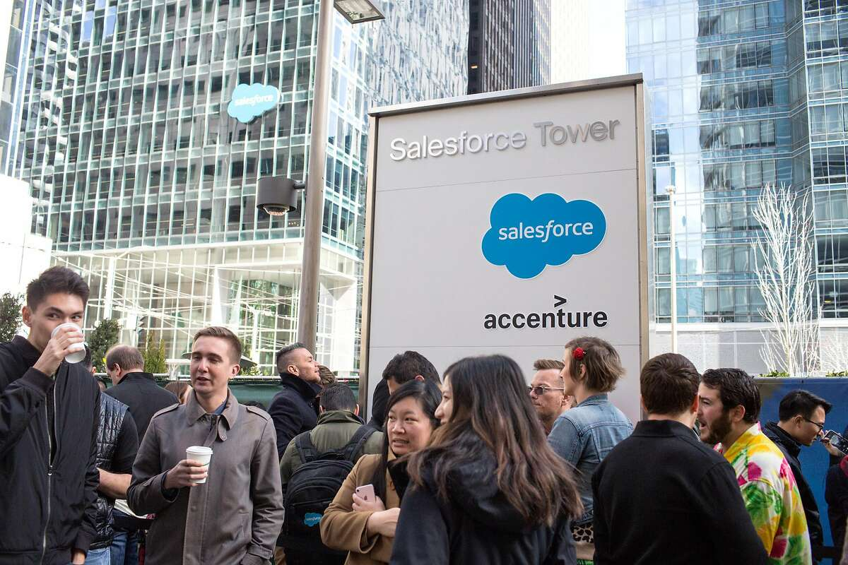 Salesforce employees wait outside of their office building to enter the plaza for a concert on the occasion of celebration of Salesforce's 20th anniversary. On Friday, March 8, 2019. San Francisco, Calif.