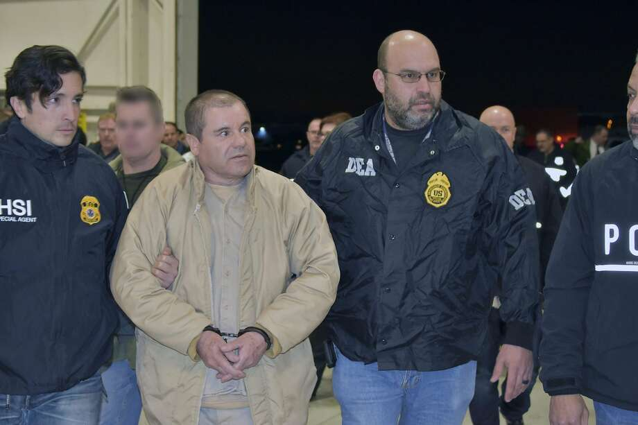 "(FILES) In this file US Department of Justice handout photo received February 19, 2019, Mexican drug baron Joaquin ""El Chapo"" Guzman, one of the world's most notorious criminals, is seen as he was extradited to the United States to face charges. - Lawyers for the convicted Mexican drug lord Joaquin ""El Chapo"" Guzman requested a new trial on March 26, 2019, saying some jurors followed media coverage of the first one, violating the judge's orders.The former Sinaloa cartel chief was found guilty on February 12 of smuggling tons of cocaine, heroin, methamphetamine and marijuana into the United States. He is scheduled to be sentenced in June and faces the prospect of life in prison. (Photo by HO / US DEPARTMENT OF JUSTICE / AFP) / RESTRICTED TO EDITORIAL USE - MANDATORY CREDIT ""AFP PHOTO / US DEPARTMENT OF JUSTICE/HANDOUT"" - NO MARKETING NO ADVERTISING CAMPAIGNS - DISTRIBUTED AS A SERVICE TO CLIENTSHO/AFP/Getty Images Photo: Ho, AFP/Getty Images"