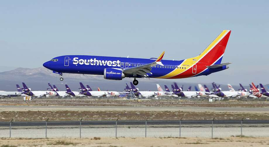 FILE – In this Saturday, March 23, 2019, file photo, a Southwest Airlines Boeing 737 Max aircraft lands at the Southern California Logistics Airport in the high desert town of Victorville, Calif. Southwest mistakenly notified thousands of Rapid Rewards members that they had achieved Companion Pass status when they had not. Photo: Matt Hartman, Associated Press