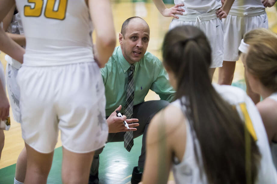 Dow High coach Kyle Theisen addresses his team during a timeout in a Jan. 25, 2019 game against Midland High. Photo: Daily News File Photo
