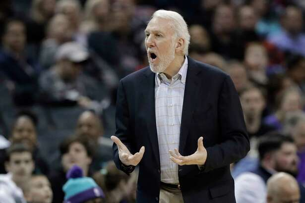 San Antonio Spurs head coach Gregg Popovich argues a call during the first half of an NBA basketball game against the Charlotte Hornets in Charlotte, N.C., Tuesday, March 26, 2019. (AP Photo/Chuck Burton)
