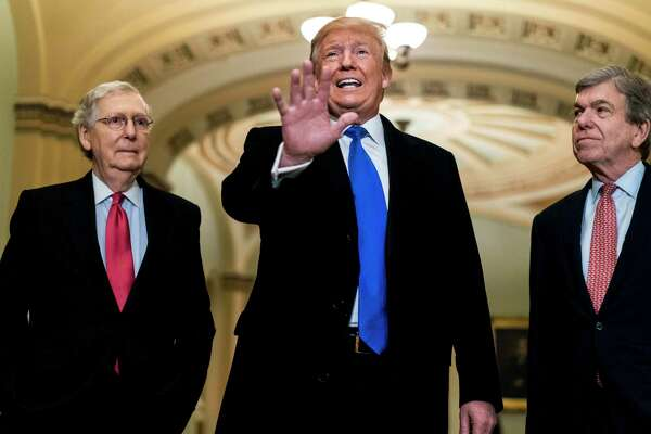 President Donald Trump, accompanied by Senate Majority Leader Mitch McConnell, R-Ky., and Sen. Roy Blunt, R-Mo., speaks to reporters before he attends the Republican Senate Caucus luncheon on Capitol Hill on Tuesday, March 26, 2019.