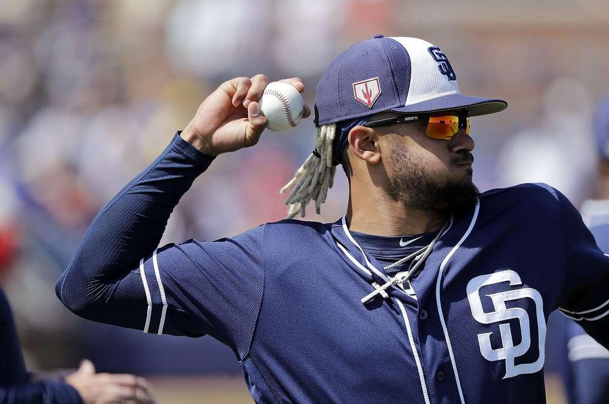 San Diego Padres' Fernando Tatis Jr. warms-up before a spring training baseball game Sunday, March 24, 2019, in Peoria, Ariz. (AP Photo/Elaine Thompson)