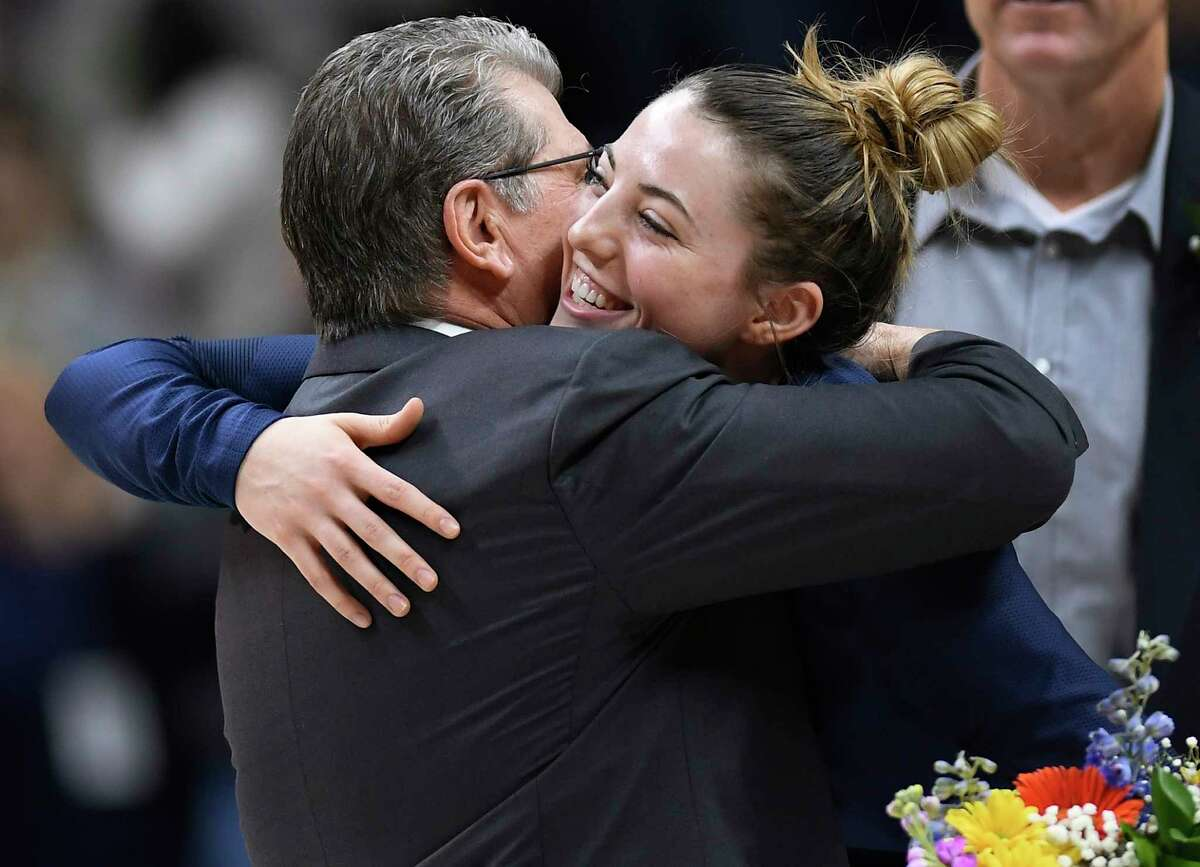 Connecticut head coach Geno Auriemma embraces Connecticut's Katie Lou Samuelson during senior night ceremonies before an NCAA college basketball game against Houston, Saturday, March 2, 2019, in Storrs, Conn. (AP Photo/Jessica Hill)