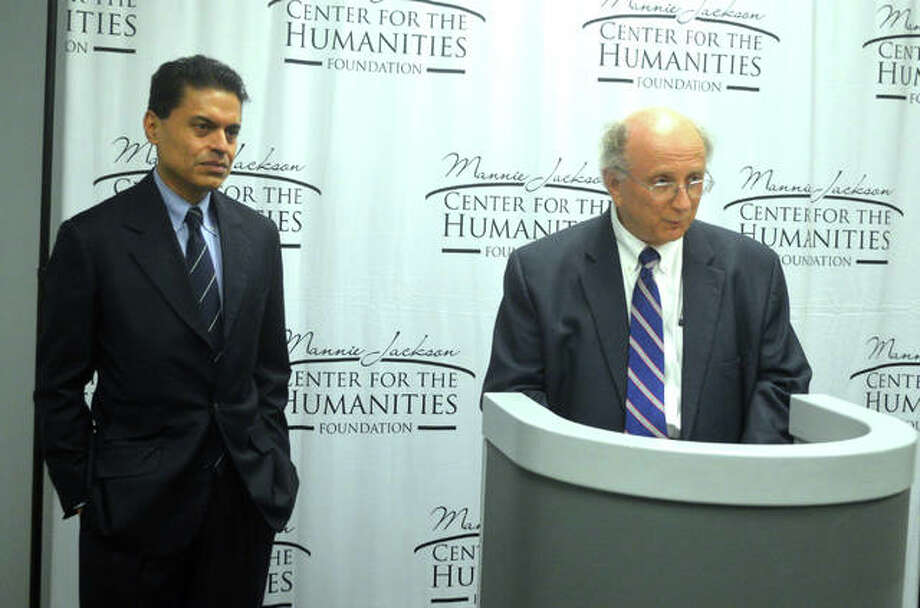 Dale Chapman, right, president of Lewis and Clark Community College, introduces international news host Fareed Zakaria at a press conference on Tuesday prior to the fourth annual Mannie Jackson Center for the Humanities Fundraiser Dinner at L&C. Zakaria, from CNN, was the featured speaker. Photo: Scott Marion/Intelligencer