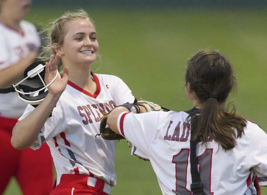 Splendora relief pitcher Shaelyn Sanders (4) gets a high-five from catcher Leah Hensarling (11) during the fifth inning of a District 21-4A high school softball game, Tuesday, March 26, 2019, in Splendora. Photo: Jason Fochtman, Houston Chronicle / Staff Photographer / © 2019 Houston Chronicle