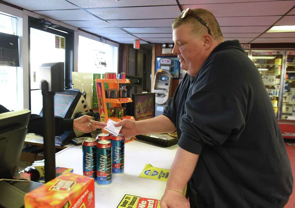 Robert Leibach of Cohoes buys a Powerball lottery ticket at Vliet Mart on Tuesday, March 26, 2019 in Albany, N.Y. The grand prize is up to $750 million. (Lori Van Buren/Times Union)