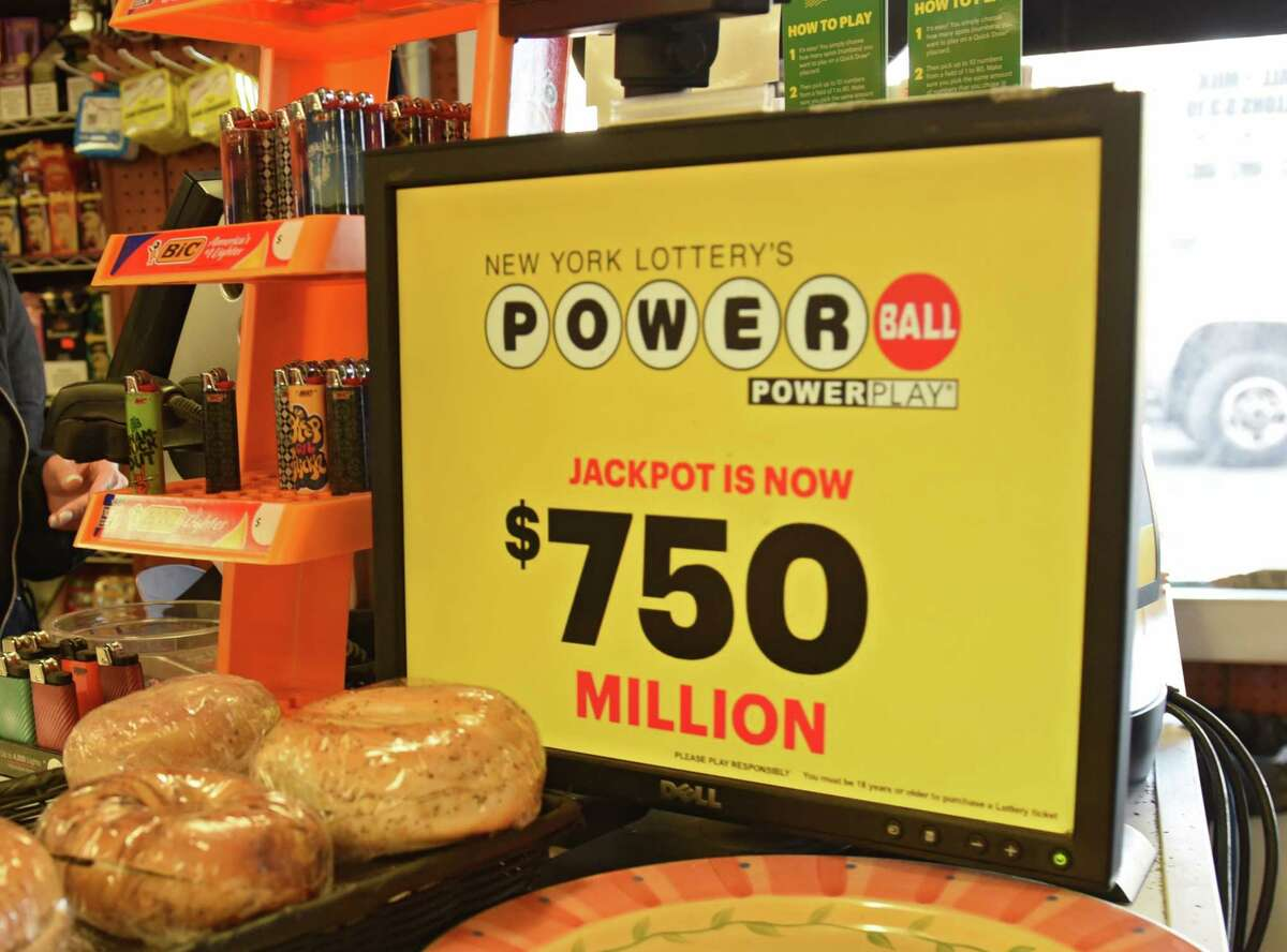 A monitor inside the Vliet Mart displays the grand prize amount of $750 million for the Powerball lottery on Tuesday, March 26, 2019, in Cohoes, N.Y. (Lori Van Buren/Times Union)