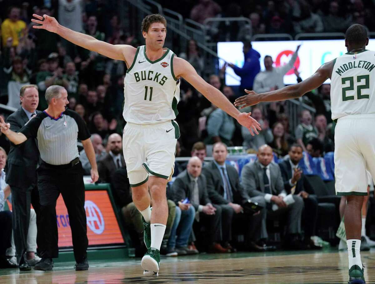 Milwaukee Bucks' Brook Lopez reacts after maiking a three-point basket during the first half of an NBA basketball game against the Houston RocketsTuesday, March 26, 2019, in Milwaukee. (AP Photo/Morry Gash)