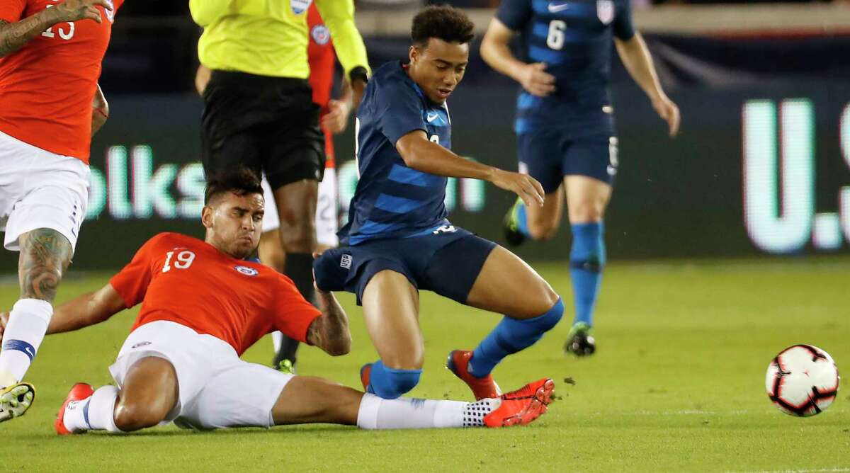 Chile defender Sebastián Vegas (19) kicks the ball away from United States forward Jonathan Lewis during the second half of an international friendly soccer match at BBVA Compass Stadium on Tuesday, March 26, 2019, in Houston.