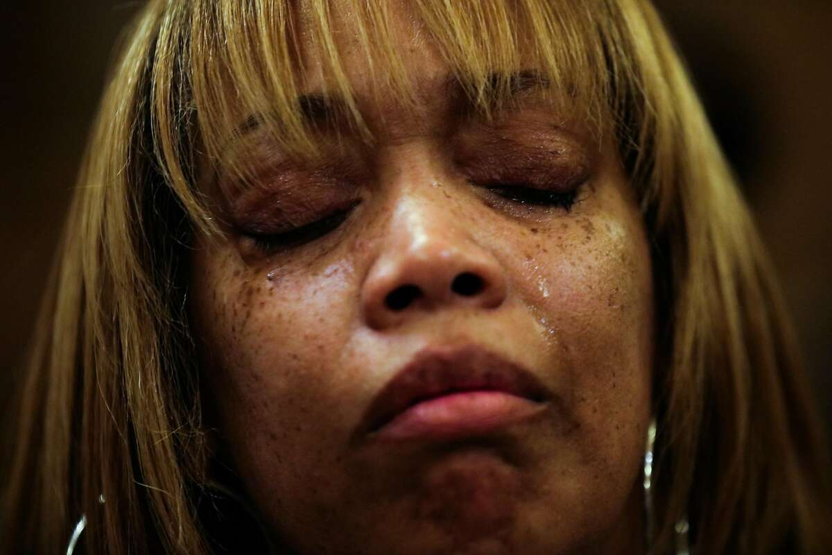 Gwen Woods, the mother of Mario Woods, who was fatally shot and killed by San Francisco Police on December 2, cries as Supervisor David Campos publicly apologizes for her son's death, at City Hall, in San Francisco, California on Tuesday, January 12, 2016.