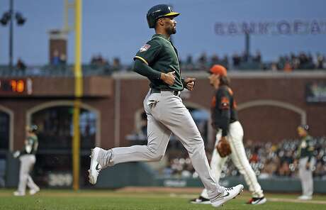 Oakland Athletics' Marcus Semien scores on Nick Hundley's 2nd inning sacrifice fly off of San Francisco Giants' Jeff Samardzija in Bay Bridge Series game at Oracle Park in San Francisco, Calif., on Tuesday, March 26, 2019. Photo: Scott Strazzante / The Chronicle