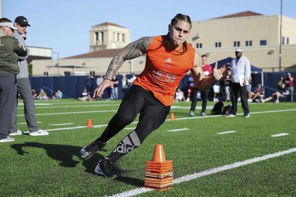 Former UTSA football player Josiah Tauaefa runs through drills and physical tests under the guise of pro football scouts as UTSA holds its Pro Day on campus on Tuesday, Mar. 26, 2019. 13 players including Tauaefa participated in hopes of landing a spot on an pro football team. (Kin Man Hui/San Antonio Express-News)