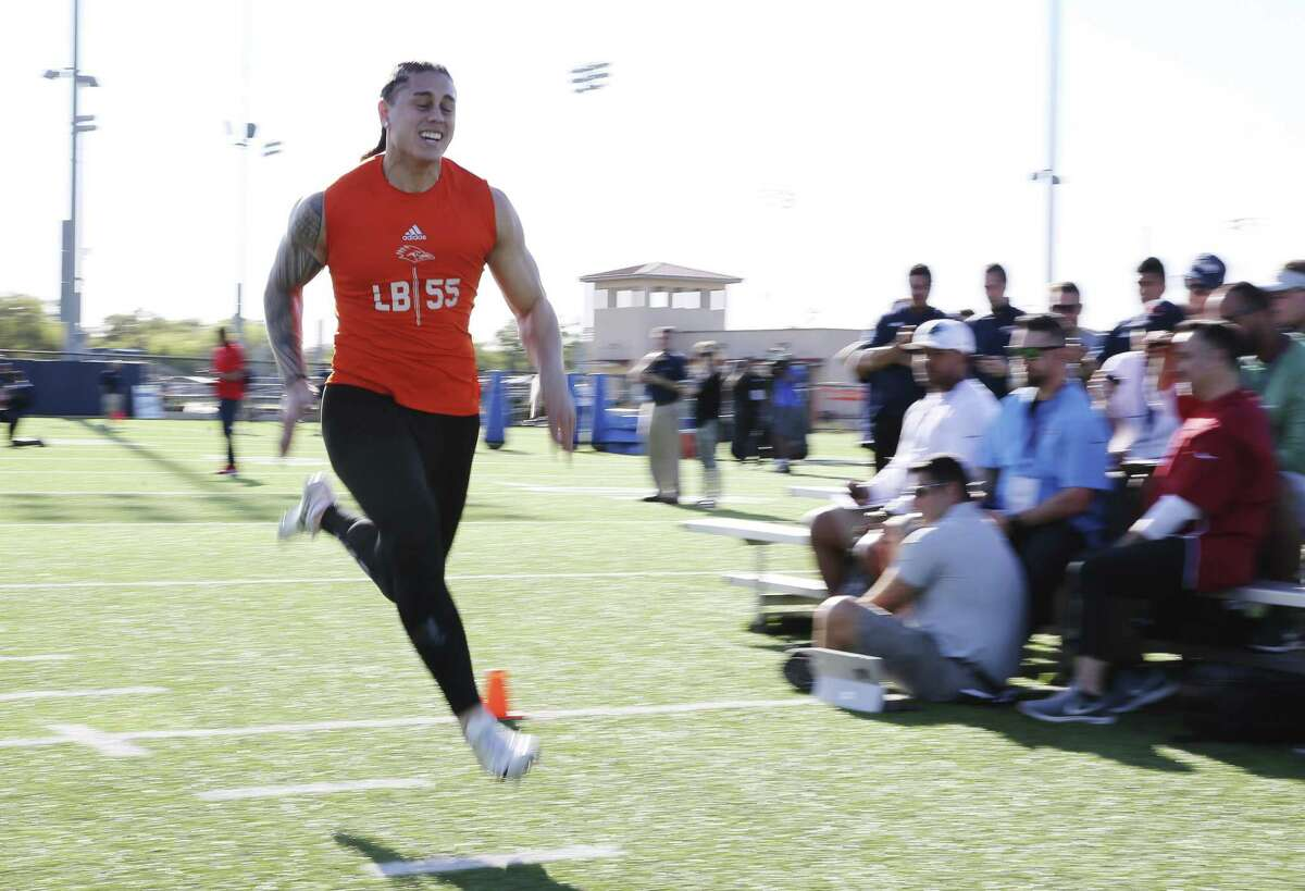 Former UTSA football player Josiah Tauaefa hits the finish line in the 40-yard run as part of drills and physical tests under the guise of pro football scouts as UTSA holds its Pro Day on campus on Tuesday, Mar. 26, 2019. 13 players including linebacker Josiah Tauaefa participated in hopes of landing a spot on an pro football team. (Kin Man Hui/San Antonio Express-News)