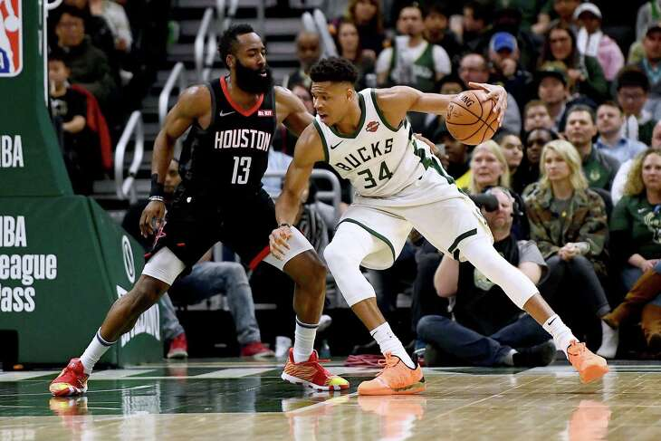 MILWAUKEE, WISCONSIN - MARCH 26:  Giannis Antetokounmpo #34 of the Milwaukee Bucks is defended by James Harden #13 of the Houston Rockets during the second half of a game at Fiserv Forum on March 26, 2019 in Milwaukee, Wisconsin. NOTE TO USER: User expressly acknowledges and agrees that, by downloading and or using this photograph, User is consenting to the terms and conditions of the Getty Images License Agreement.