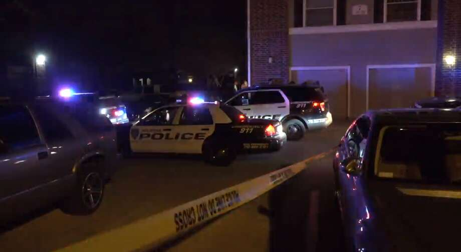 Houston police said a masked, rifle-wielding suspect was shot when he approached another man sitting in his car in a north Houston apartment complex. The victim had been waiting to buy or sell a video game at the complex, police said. Photo: Metro Video
