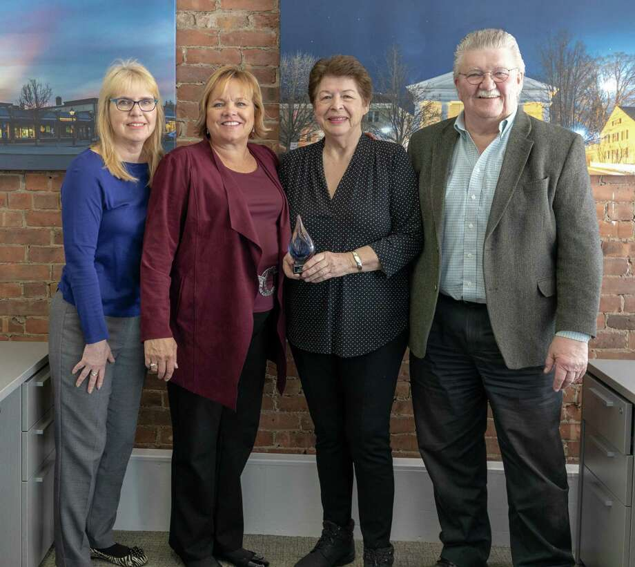 Maria Busi, third from left, was recently named the 2018 Realtor of the Year for the Greater New Milford Board of Realtors. Busi is shown with William Raveis's New Milford Manager Eileen Brooks, second from left, and past Realtors of the Year, from left to right, Audrey Wilkicki (2015) and Wayne Piksura (2016) Missing is Elaine Barksdale (2017). Photo: Courtesy Of Dean Webster / The News-Times Contributed