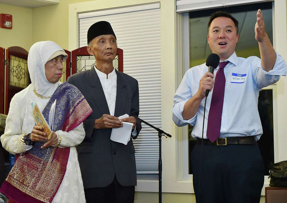 William Tong, then-Democratic candidate for attorney general, speaks about immigration at a service held for Indonesian immigrants Sujitno Sajuti and his wife, Dahlia, who have been in sanctuary for one year at the Unitarian Universalist Church in Meriden in October 2018.