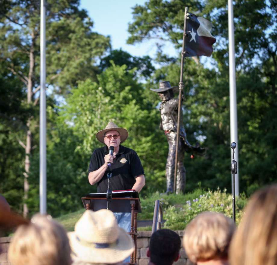"""2011 Texas State Poet Laureate Dave Parsons reads his poem """"The Texian"""" at a previous San Jacinto Day celebration at the Texas Flag Park. The Montgomery County Literary Arts Council is seeking donations to complete an installation of the poem at the flag park by April 21."""