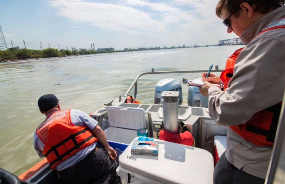 Members of the Texas Commission on Environmental Quality collect water samples from the affected area of the Houston Ship Channel near La Porte Texas on March 20, 2019.