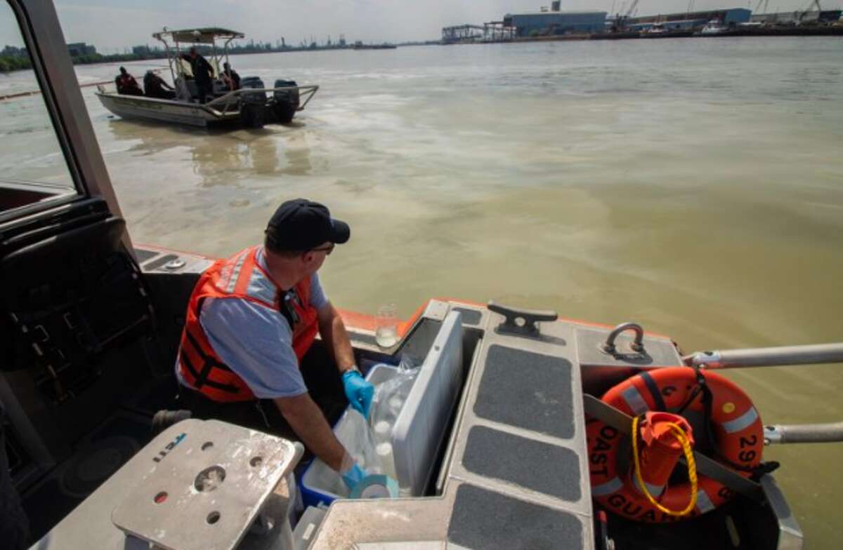 Members of the Texas Commission on Environmental Quality collect water samples from the affected area of the Houston Ship Channel near La Porte, Texas, on March 20, 2019.