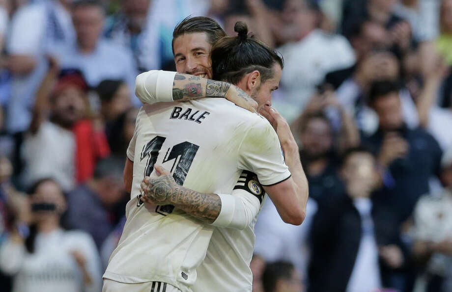 Real Madrid's Gareth Bale, right, celebrates with his teammate Sergio Ramos after scoring during a Spanish La Liga soccer match between Real Madrid and Celta at the Santiago Bernabeu stadium in Madrid, Spain, Saturday, March 16, 2019. (AP Photo/Paul White) Photo: Paul White, Associated Press / Copyright 2019 The Associated Press. All rights reserved