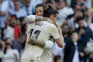 Real Madrid's Gareth Bale, right, celebrates with his teammate Sergio Ramos after scoring during a Spanish La Liga soccer match between Real Madrid and Celta at the Santiago Bernabeu stadium in Madrid, Spain, Saturday, March 16, 2019. (AP Photo/Paul White)