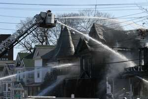 One house was destroyed and another sustained critical damage after a fire on March 27, 2019, on Georgetta Dix Plaza in Schenectady that left at least nine adults and children homeless.