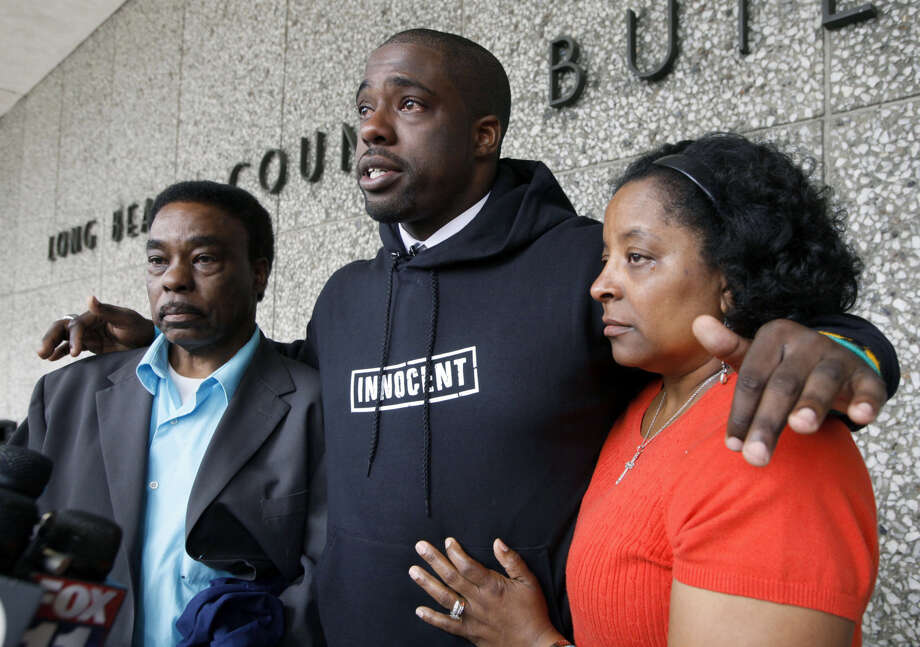 Brian Banks, center, reacts with his mother, Leomia Myers, and father, Jonathan Banks, outside court after his rape conviction was dismissed in Long Beach, Calif., in May 2012. Brian Banks' memoir about being wrongfully accused of rape will be published in July, and a feature film based on his book will be out in August. Photo: AP File Photo