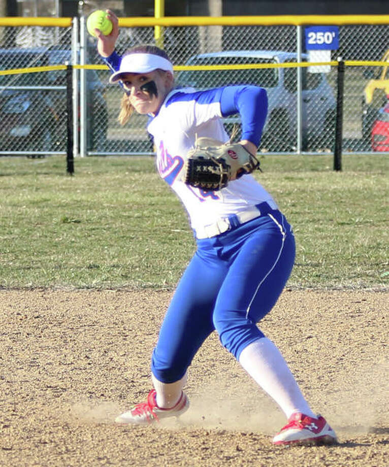 Roxana shortstop Abi Stahlhut, shown throwing to first for an out in a game earlier this season, was back at Roxana Park on Tuesday and hit two home runs in the Shells' eight-inning loss to Marquette Catholic. Photo: Greg Shashack / The Telegraph