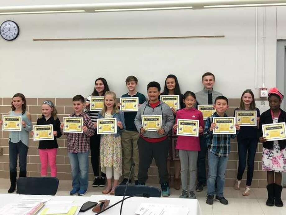 Edwardsville school district's top 19 students, some pictured, recently competed in the 10th Spelling Bee on Feb. 20. District 7 named Selin Aktuna as the champion and Miles Massey as the runner-up. Other top spellers included Kacey Williams, David Huang, Sara Davis, Madison Deck, Nolan Rowe, Nadia Kuhlman, Gabriella Hill, Natalie Becker, Brayden Steelman, Alexis Haas, Kaan Demirer, Grace Capron, Abigail Hildenbrand, Jared Johnson, Amelia Zhang, Andrew Wang, and Yorm Nutsukpui. Photo: Julia Biggs | The Intelligencer