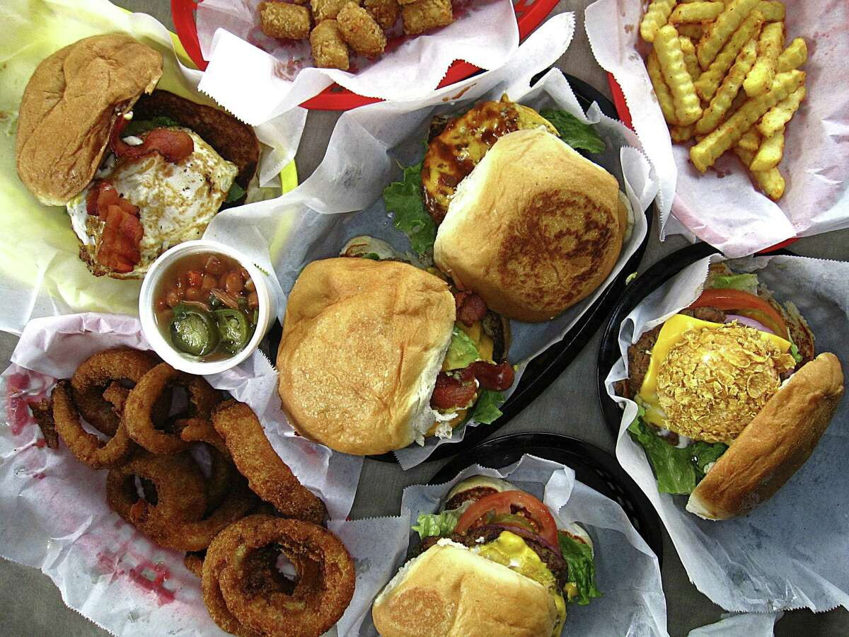 Burgers, sides and free beans fill the table at Mark's Outing.