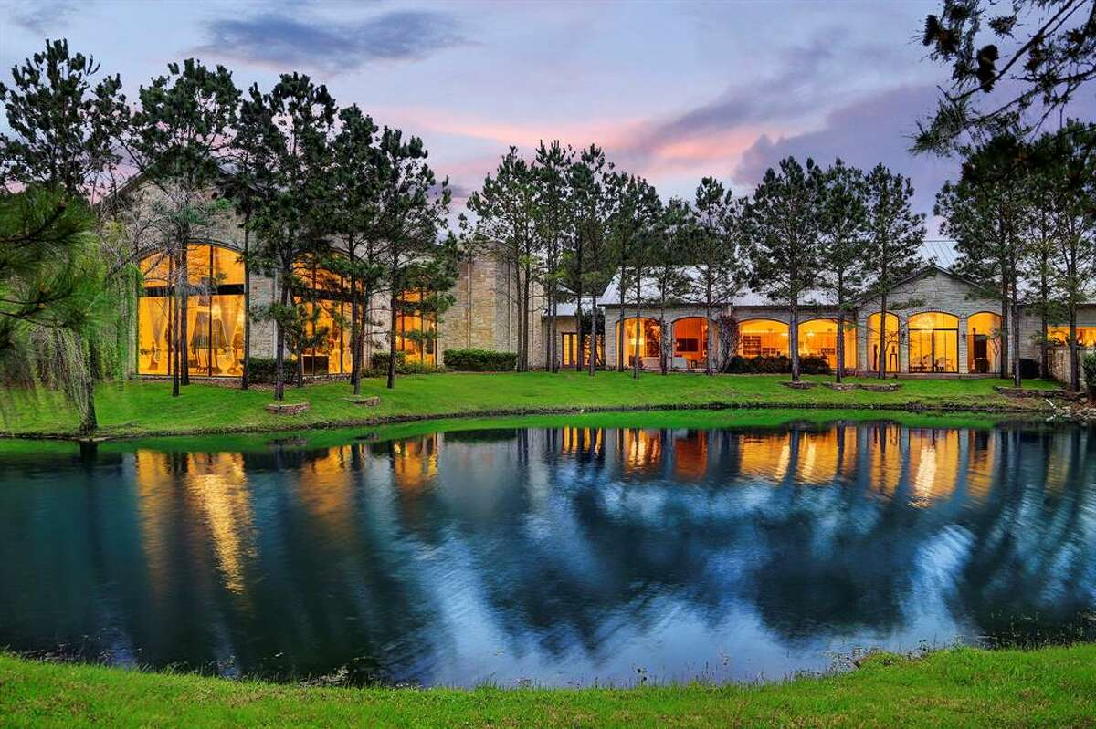 Located at 19055 Hufsmith Kohrville Road, this 64-acre resort-like home in Tomball offers the perfect getaway with stunning lakefront views and natural wildlife surroundings. Outfitted with five bedrooms and six full and two half bathrooms, the home boasts impressive amenities like a custom theater, large swimming pool and separate lap pool, wine room, climate controlled 12-car garage, a stunning guest house, covered tennis court, horse stables and a horse arena.