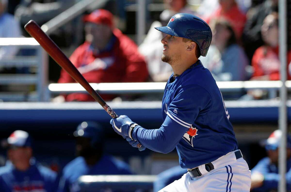 Toronto Blue Jays' Cavan Biggio watches his home run off Philadelphia Phillies starting pitcher Vince Valasquez during the second inning of a spring training baseball game Wednesday, March 6, 2019, in Dunedin, Fla. (AP Photo/Chris O'Meara)