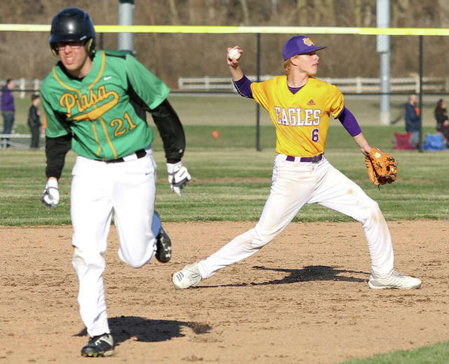 CM shortstop Keaton Loewen (right) fires to first for the inning's third out while Southwestern's Noah Kelly advances to third in a prep baseball game Tuesday at the Bethalto Sports Complex. Loewen had three hits in the Eagles' win. Photo: Greg Shashack / The Telegraph