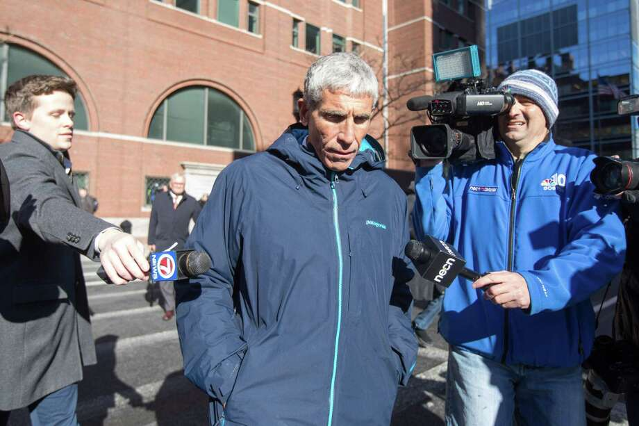 """William """"Rick"""" Singer leaves Boston federal court after being charged with racketeering conspiracy, money laundering conspiracy, conspiracy to defraud the United States, and obstruction of justice on March 12, 2019,. Singer is the central figure in an alleged college admissions scam involving parents, ACT and SAT administrators and coaches at universities including Stanford, Georgetown, Yale, and the University of Southern California. Photo: Scott Eisen / Getty Images / 2019 Getty Images"""