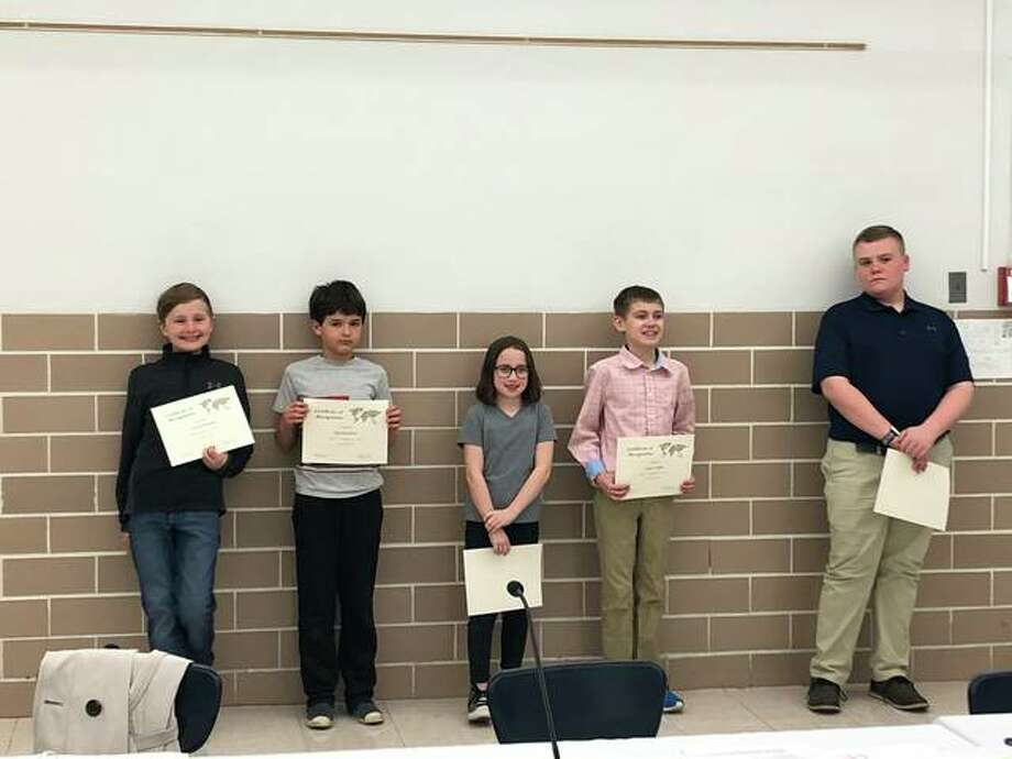 District 7 National Geographic Bee winners were recognized at the Edwardsville School Board of Education meeting. School winners pictured (L to R) are George Ostrom, Dan Rashman, Margaret Stacy, Logan Tallon, Case Warner, and Hudson Dickhaus (not pictured). Rashman, a Woodland fourth-grader, and Dickhaus, a Liberty Middle eighth-grader, qualified for the state competition by placing among the top 100 scorers in the state. They will participate in the state competition in Normal on March 29. Photo: Julia Biggs | The Intelligencer