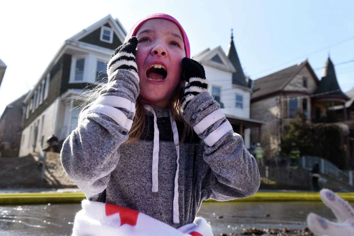 Skyelar Eriole, 5, one of the displaced residents of a Georgetta Dix Plaza fire, recalls how she escaped from the blaze on Wednesday morning, March 27, 2019, in Schenectady, N.Y. A morning fire struck two houses and left at least nine adults and children homeless in Hamilton Hill. (Will Waldron/Times Union)