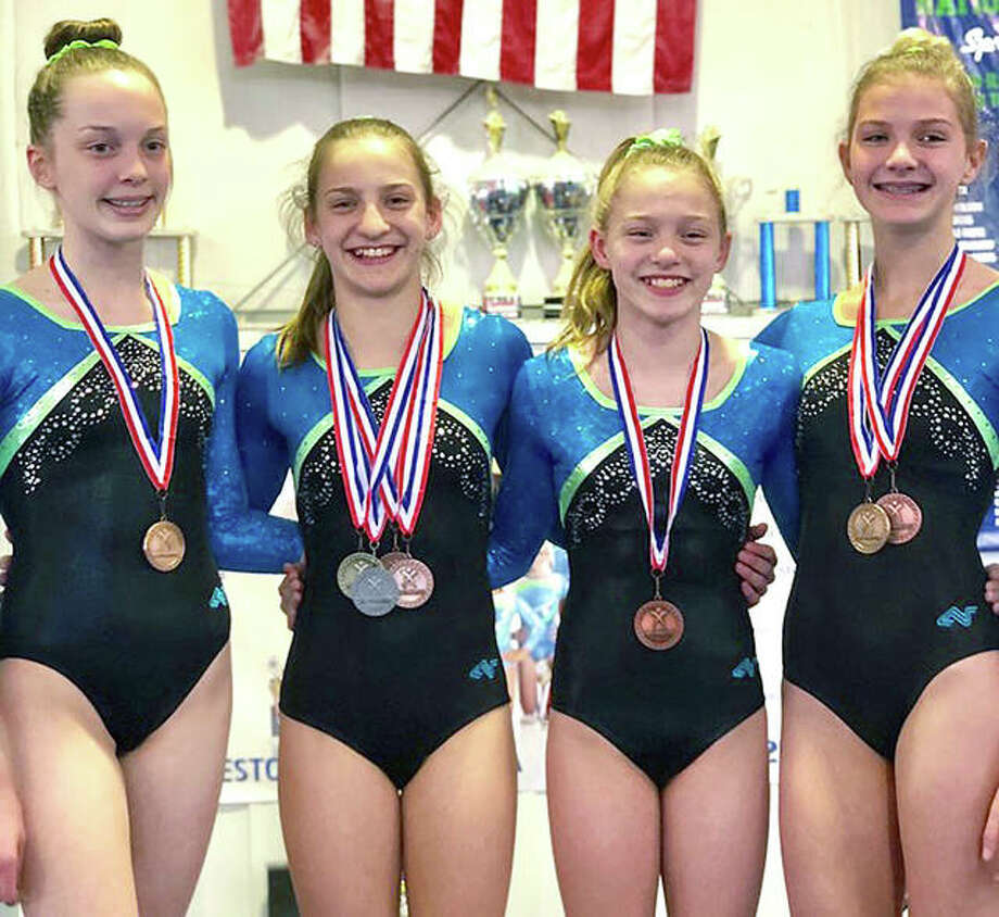 Mid Illinois gymnasts from Godfrey brought home hardware from the recent Illinois State championships in St. Charles. In Senior E competition, Sammy Hentrich was seventh in All-Around (36.925 points), first on vault (9.5), first on floor exercise (9.65) and eighth on the balance beam (9.275). Senior D Sophie Rose was fifth on vault, eighth on uneven parallel bars and had an all-around score of 35.75. In Junior F competition, Caroline Cain was fifth on uneven bars and in Senior F, Ruby Pruitt finished seventh on floor exercise. Photo: Submitted Photo