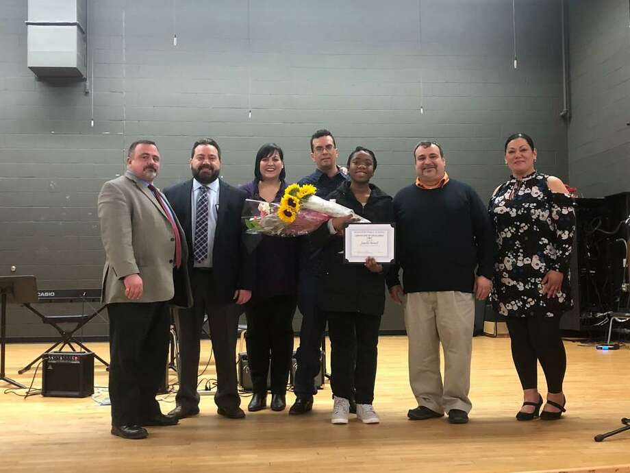 Six members of the Bridgeport Board of Education and Connecticut Spelling Bee champ Janelle Newell at a recognition program held Monday, March 25, 2019 at Batalla School Photo: Contributed