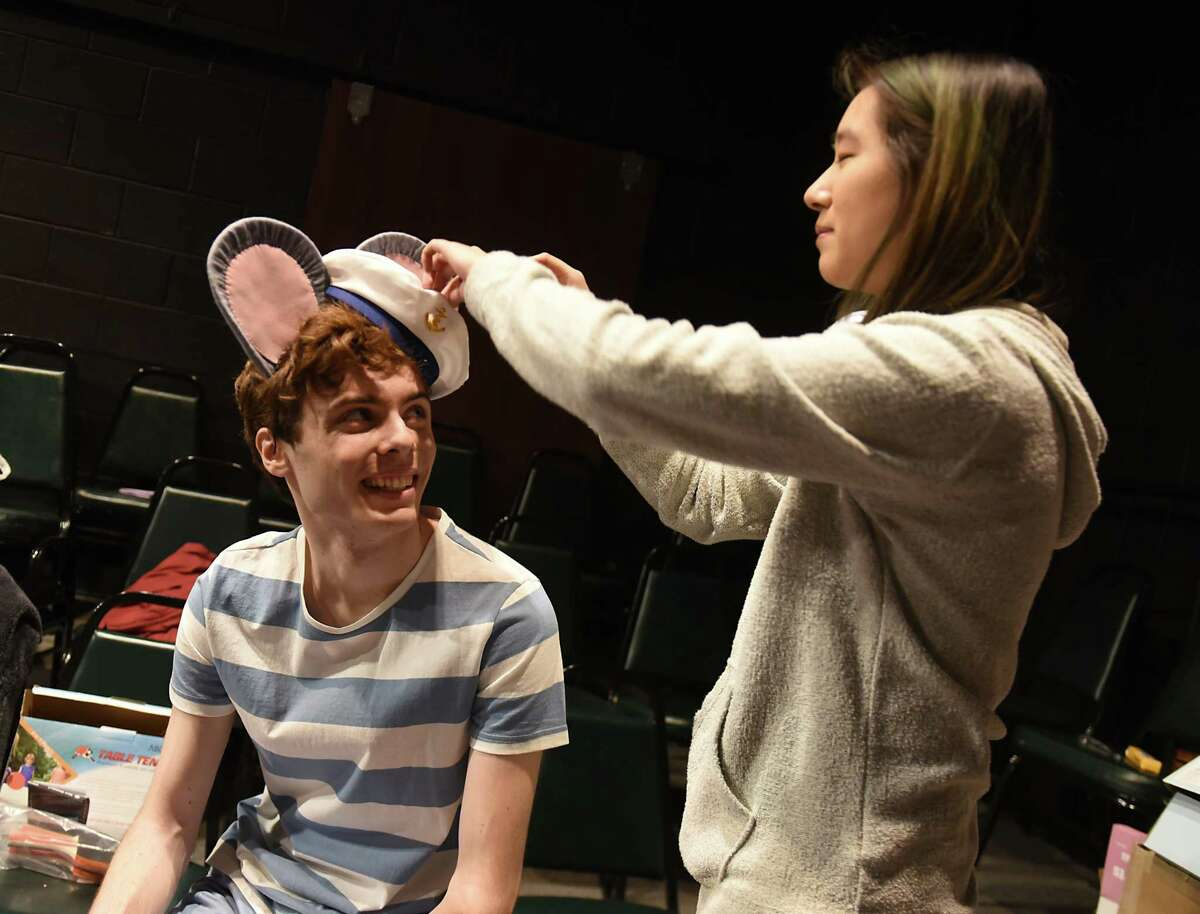 Props master Juliet Park fixes a hat on the ears of actor Matthew Dulchinos, playing Stuart Little, during rehearsal of a kid-focused version of the E.B. White story