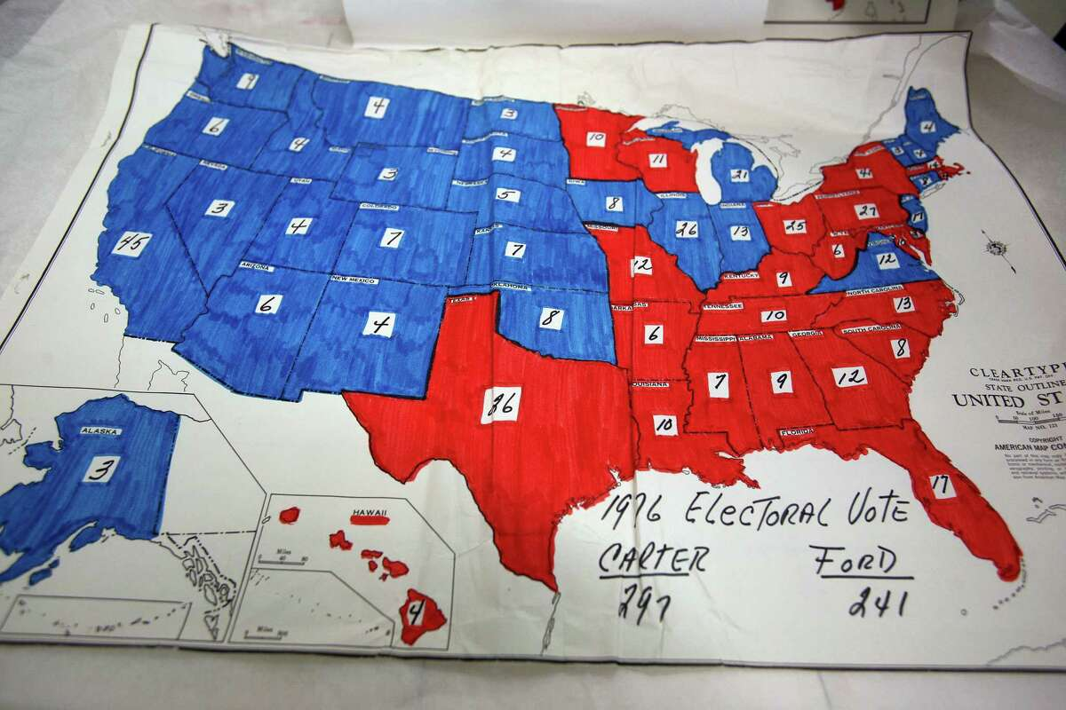 FILE -- An Electoral College map from the 1976 Carter/Ford campaign that was used by the 1980 Reagan campaign to strategize, at the Ronald Reagan Presidential Library in Simi Valley, Calif., Dec. 4, 2008. In those days, the blue states represented Republican states and the red ones Democratic states The Electoral College's winner-take-all system within states can produce results counter to the majority for no high-minded reason. (Monica Almeida/The New York Times)