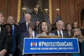 """Speaker of the House Nancy Pelosi, D-Calif., flanked by Majority Whip James E. Clyburn, D-S.C., left, and House Majority Leader Steny Hoyer, D-Md., right, leads an event to announce legislation to lower health care costs and protect people with pre-existing medical conditions, at the Capitol in Washington, Tuesday, March 26, 2019. The Democratic action comes after the Trump administration told a federal appeals court that the entire Affordable Care Act, known as """"Obamacare,"""" should be struck down as unconstitutional. (AP Photo/J. Scott Applewhite)"""