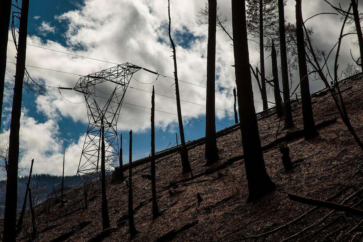 The Pacific Gas & Electric (PG&E) Caribou-Palermo transmission line runs through an area that was devastated by the Camp Fire in November 2018 in Pulga, Calif., Feb. 28, 2019. The California utility left outdated towers in place and was slow to reduce hazards. Now it faces billions in liability claims over a series of blazes. (Max Whittaker/The New York Times)