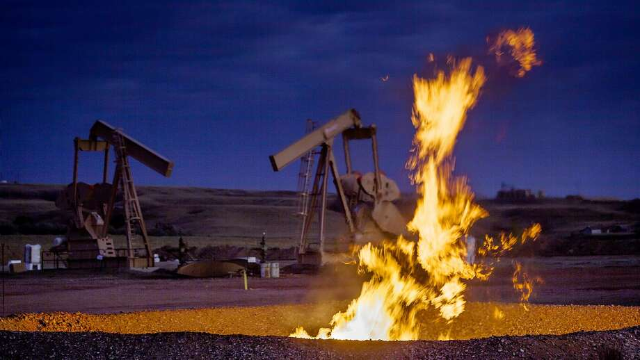 Flames from a flaring pit near a well in the Bakken Oil Field.  Photo: Orjan F. Ellingvag / Corbis / Getty Images, Corbis Via Getty Images
