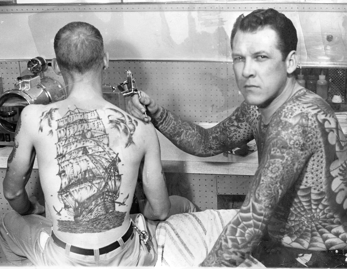 Tattoo artist Lyle Tuttle at work in his studio, January 1966.