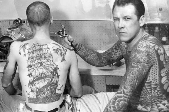 Tattoo artist Lyle Tuttle, at work in his studio, January 1966  Handout