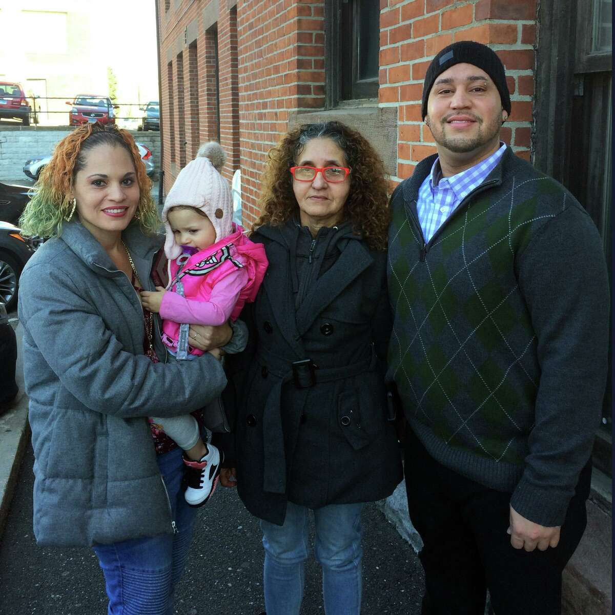 The Mendez family, arrested during a now-controversial incident in October 2017, wait outside the Golden Hill Street courthouse in Bridgeport recently. From Left, Wanda Mendez, her 2-year-old daughter, Sara Mendez and Carmelo Mendez