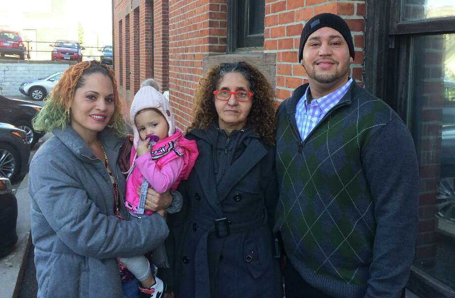 The Mendez family, arrested during a now-controversial incident in October 2017, wait outside the Golden Hill Street courthouse in Bridgeport on Wednesday where their criminal cases are still pending. From Left, Wanda Mendez, her 2-year-old daughter Niasyria, Sara Mendez and Carmelo Mendez Photo: Dan Tepfer / Hearst Connecticut Media / Connecticut Post
